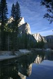 View from the river. Reflection of the mountain in the water in this view from the river in Yosemite National Park Stock Image