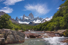 View from the river on a beautiful plumose cloud over Fitz Roy m Stock Images