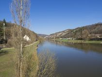 View on river Berounka from pedestrial bridge in village Srbsko in central Bohemian region on on spring sunny day, blue. Sky stock images