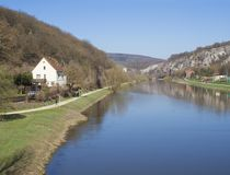 View on river Berounka from pedestrial bridge in village Srbsko in central Bohemian region on on spring sunny day, blue. Sky royalty free stock image