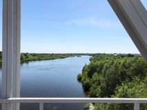 View of the river and the blue sky with clouds from the railway bridge.  stock photos