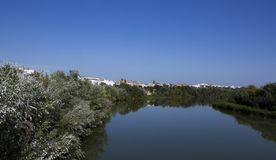 View on the river from the bridge. Shot in color detail on the river Guadalquivir crossing the city, sculpture of this historic building the mosque, representing royalty free stock image
