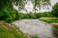 A view of River Don flowing in Seaton park in summer time, Aberdeen. City, Scotland Royalty Free Stock Image