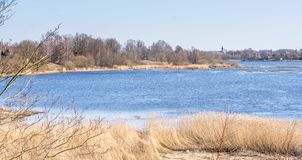 View of the river in early spring on a sunny day stock photos