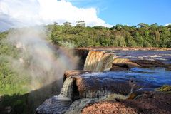View of the river East Berbice front of the Kaieteur falls, Guyana. The waterfall is one of the most beautiful and majestic waterf stock photography