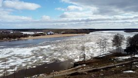 View of the river frozen in the spring timelapse on a sunny day. View of the frozen river timelapse in spring on a Sunny day in March stock footage