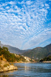 View of River Ganga and amazing blue sky with little clouds at beautiful colorful day. Rishikesh. India Stock Photo