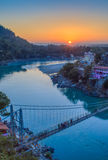 View of River Ganga and Lakshman Jhula bridge at sunset. Rishikesh. India Royalty Free Stock Photos