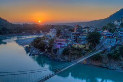 View of River Ganga and Lakshman Jhula bridge at sunset. Rishikesh. India Stock Images