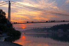 View of River Ganga and Ram Jhula bridge at sunset Royalty Free Stock Photography