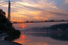 View of River Ganga and Ram Jhula bridge at sunset Royalty Free Stock Photography