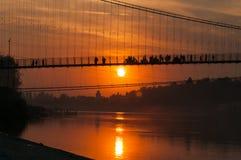 View of River Ganga and Ram Jhula bridge at sunset Stock Photos