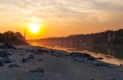 View of River Ganga and Ram Jhula bridge at sunset Stock Images
