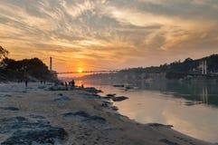 View of River Ganga and Ram Jhula bridge at sunset Stock Photography