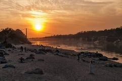 View of River Ganga and Ram Jhula bridge at sunset Stock Image