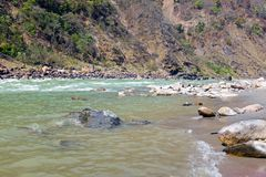View on the river Ganges near Laxman Jhula in India. Asia royalty free stock photo