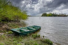 View of the river with grass and boat, in Porto do sabugueiro, muge, santarem portugal stock photography