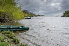 View of the river with grass and boat, in Porto do sabugueiro, muge, santarem portugal royalty free stock photo