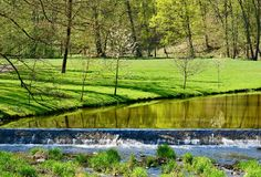 Green park. View of a river in the green park in a sunny day. Vlasim castle park royalty free stock photo