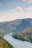 View of river from greenery mountain with blue sky Royalty Free Stock Image