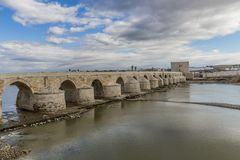 View of the river Guadalquivir river and the Roman bridge of Cordoba. Beautiful view of the river Guadalquivir river and the Roman bridge of Cordoba in a stock photo