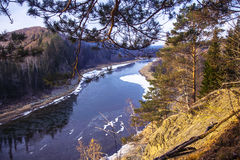 View of the river from a high cliff early autumn. River under the first snow, a high cliff, sunny day Stock Photography