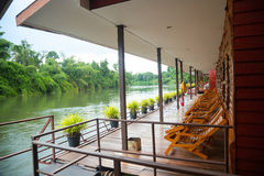 View of the river in a houseboat. Wooden beds royalty free stock photography