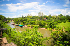 View river Kwai. The view of the river. Small houses on the river. Blue sky with clouds Stock Images