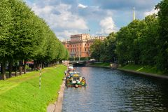 View of the River Moika in front of Mikhailovsky Gardens. RUSSIA, SAINT PETERSBURG - AUGUST 18, 2017: View of the River Moika in front of Mikhailovsky Gardens Stock Photos