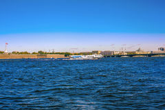 A view of the river Neva and the Peter and Paul fortress in Saint-Petersburg. View of the Neva River, a floating hydrofoil ship, Peter and Paul Fortress and the Royalty Free Stock Photos