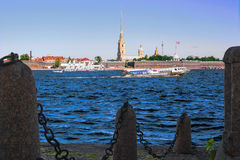 A view of the river Neva and the Peter and Paul fortress in Saint-Petersburg, Russia. View to the granite embankment of the Neva river and the Peter and Paul Royalty Free Stock Photo