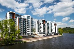 View of a river and the new residential houses stock images