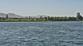 View of river nile in Egypt showing Luxor west bank stock video