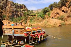 View on river in Ourika valley with wooden colorful raft and muslim family - Morocco royalty free stock photo