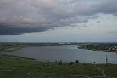 View of the river, over which gathered thunderclouds stock photos