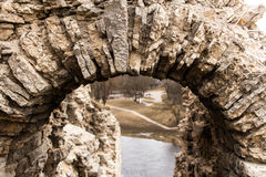 View of the river and park through the arch of the ancient tower royalty free stock images