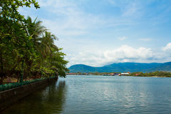 View of the river by a riverside temple of Kampot, Cambodia Royalty Free Stock Photography