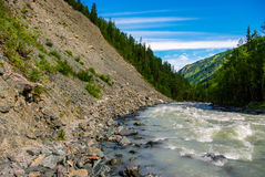 View of the river and the rocky scree-covered forest in the mountains Royalty Free Stock Photos