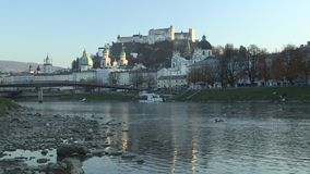 View from the river Salzburg to the Inner City of Salzburg, Austria, Europe. View from the river Salzburg to the Inner City of Salzburg,   Austria in Europe stock video