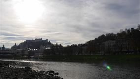 View from the river Salzburg to the Inner City of Salzburg, Timelapse, Austria, Europe. View from the river Salzburg to the Inner City of Salzburg, Timelapse stock video