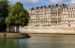 View of River Seine quayside and tip of Île Saint Stock Photos