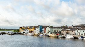 View of the river Shannon with boats anchored on the coast and the town of Athlone. With picturesque houses, wonderful and relaxed day in the county of royalty free stock photography