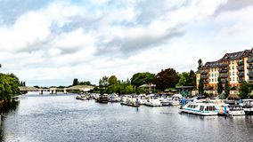 View of the river Shannon with boats anchored at the dock with the railway bridge in the background. In Athlone town, wonderful and relaxed day in County royalty free stock photo