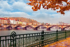 View on the  river and stone bridge in autumnal Prague Royalty Free Stock Photos