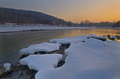 View of the river after sunset in winter. Evening view. Caucasus, Russia Royalty Free Stock Photos