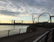 Transporter Bridge and Temenos. View of the river Tees at sunset with Temenos pictured and the famous Transporter Bridge Stock Photos