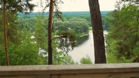 View on river from terrace. View on river in the forest at summer from terrace stock footage