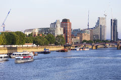 View of the River Thames and modern glazed office buildings, London, United Kingdom. LONDON, UNITED KINGDOM - JUNE 21, 2017: View of the River Thames and modern Royalty Free Stock Images