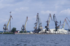 View from the river to the port cranes in the river port. On the Dnieper stock photos