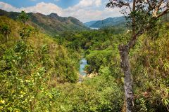 The view of river and Waterfall El- Nicho and trees and mountains in Cuba stock photography